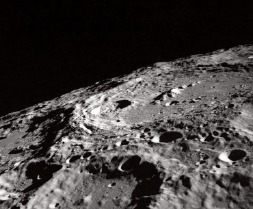 Black and white photo of the moon's surface.