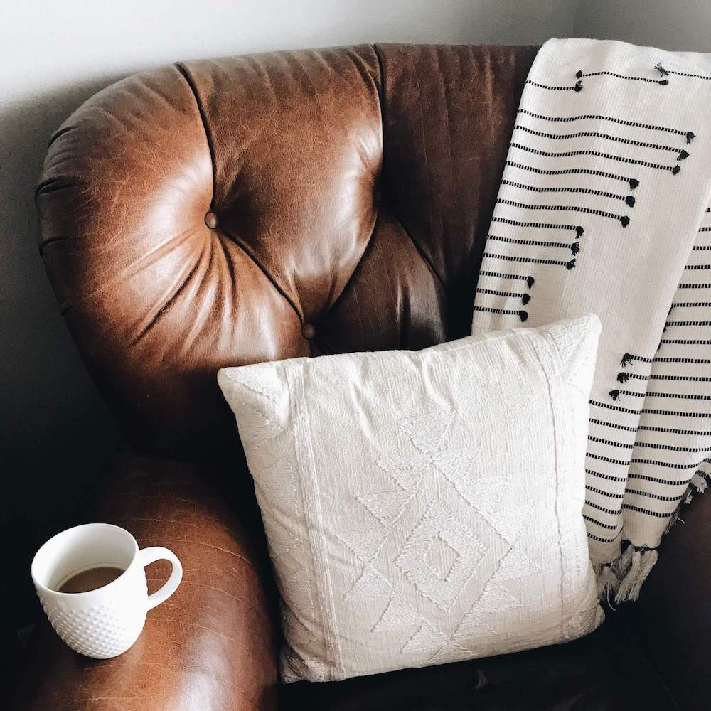 Photo of a comfortable brown leather chair.